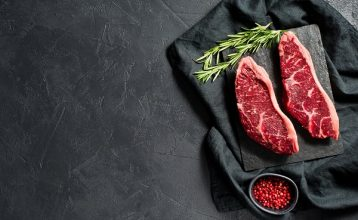 Raw beef ramp steak. Black background, top view.