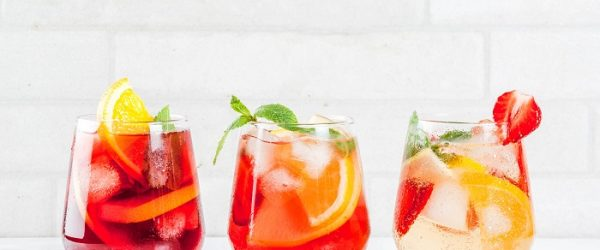 Cold white, pink and red sangria cocktails with fresh fruits, be